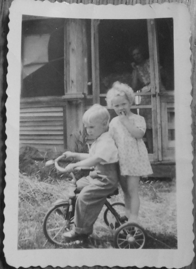 """This is my Uncle Dallas on the bike and my mom, Elaine riding on the back. My mom said her nick name growing up was """"ping pong"""" because her hair was white blond as a child."""