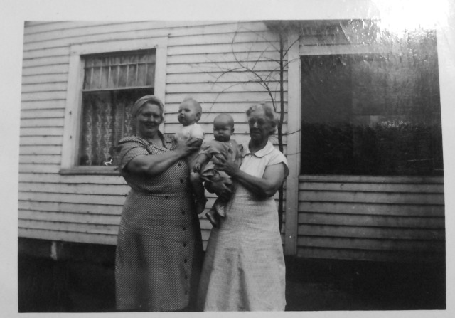 This is my my Great Grandmother (left) holding my Aunnt Jackie and my Great Great Grandmother (right) holding my Uncle Dallas)