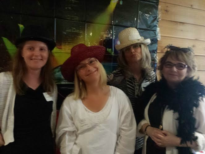 A few of our wine and words authors having fun at the photo booth!  Left:  Catherine McKenzie, Barbara Claypole White, Lorna Landvik, and Randy Susan Meyers